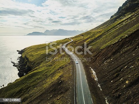 istock Car driving on beautiful scenic road in Iceland. 1061249882