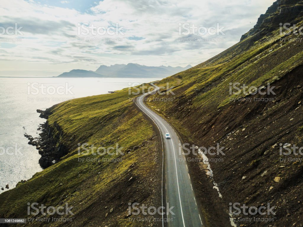 Car driving on beautiful scenic road in Iceland. stock photo