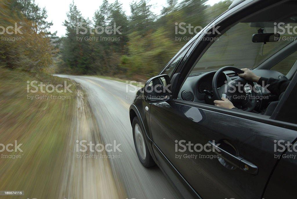 Car driving on country road royalty-free stock photo