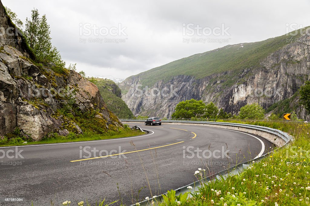 Car driving on Hardangervidda road in Norway stock photo