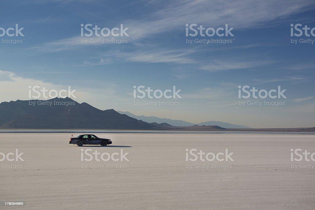 Car driving on Salt Flats stock photo