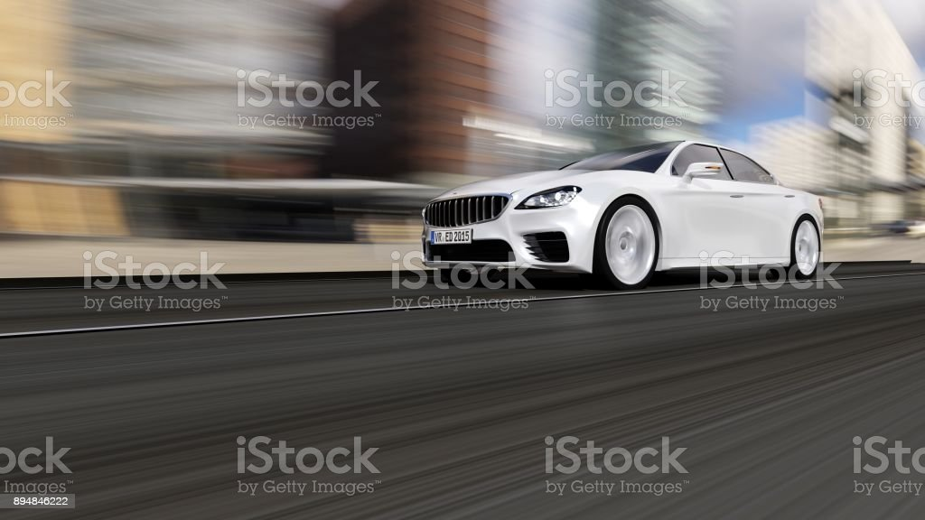 car driving on urban road stock photo