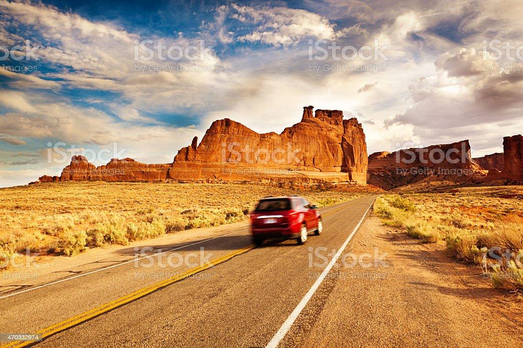Car Driving Road Trip Touring at Arches National Park Utah stock photo