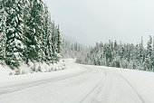 A car travelling down a snowy road in British Columbia, Canada.