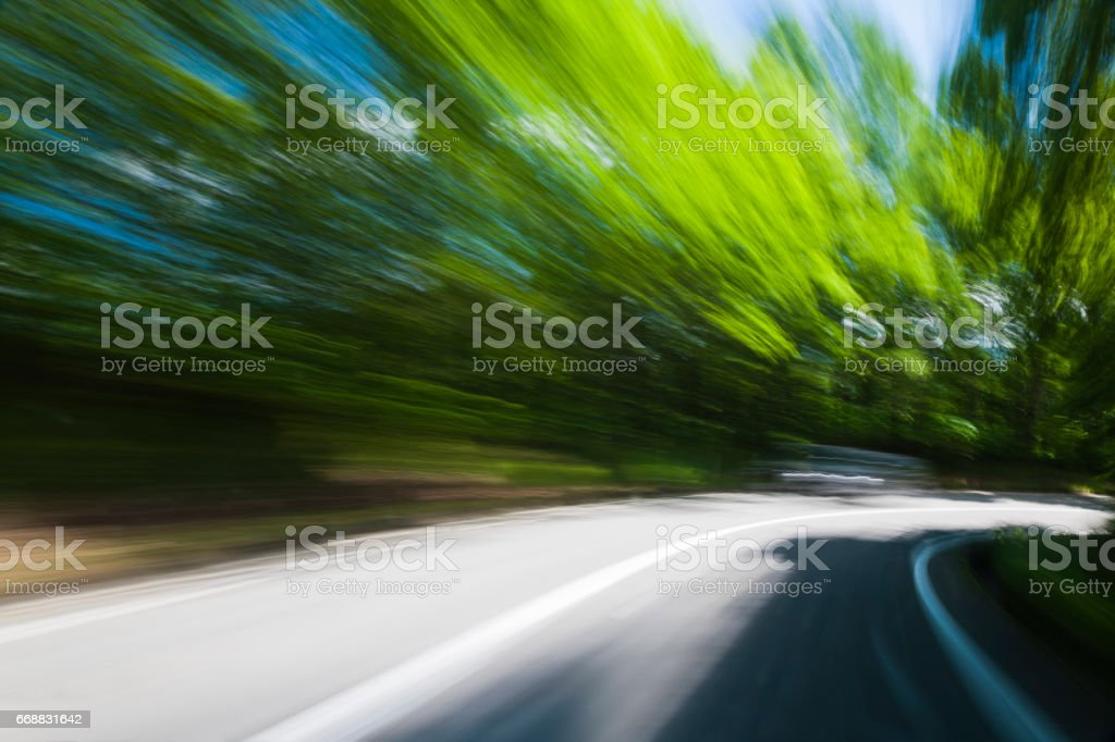 Car Driving Through Forest Road stock photo