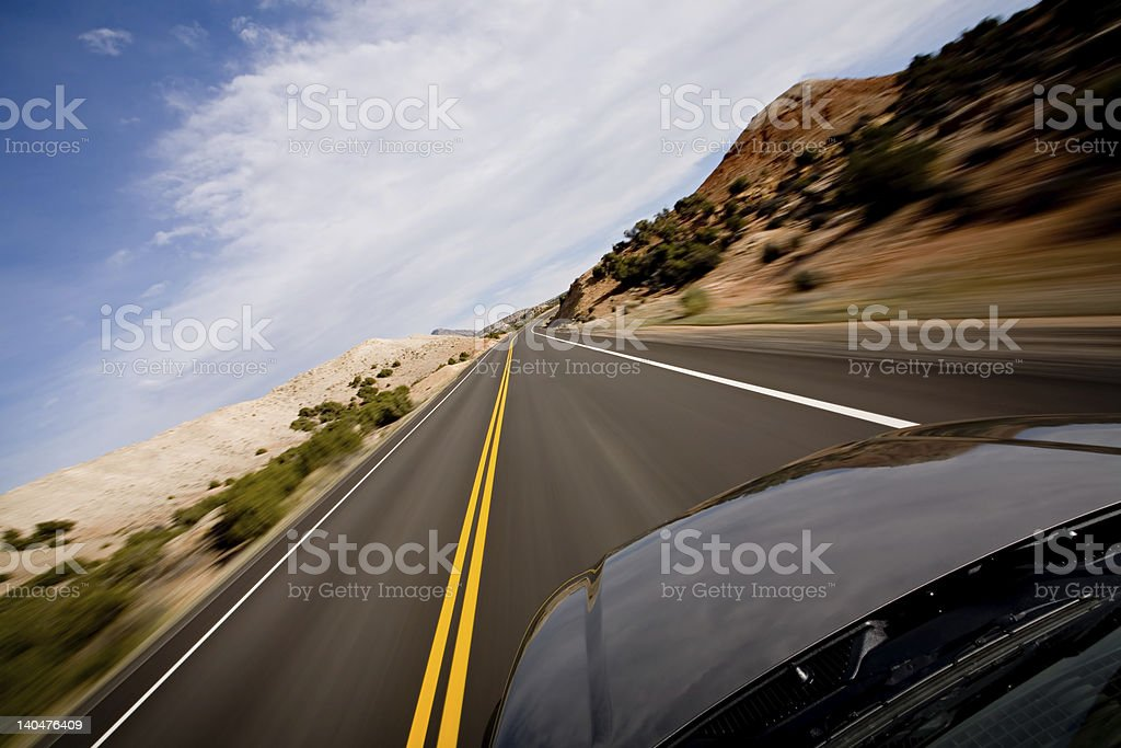 Car driving through the desert in high speed royalty-free stock photo