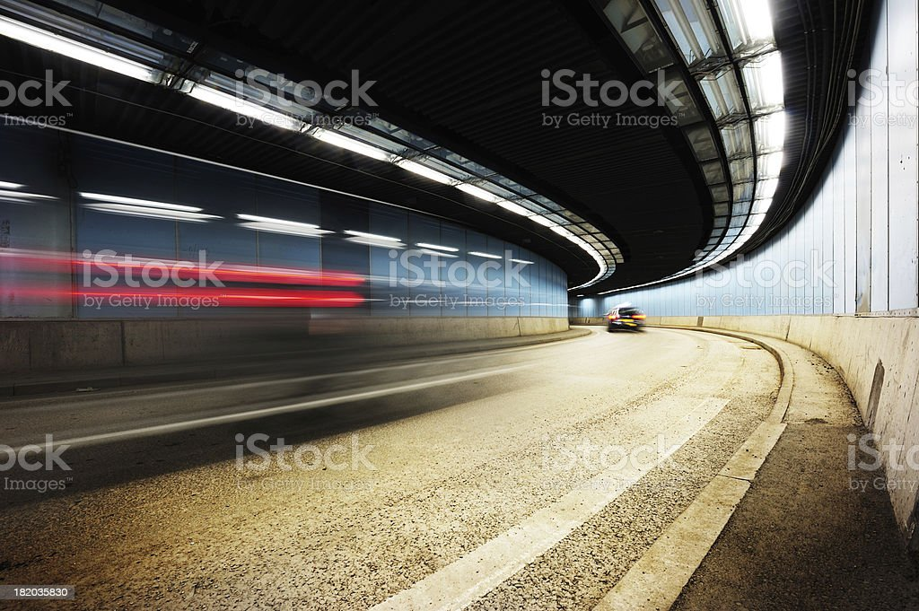 Car driving through tunnel by night, diminishing perspective stock photo
