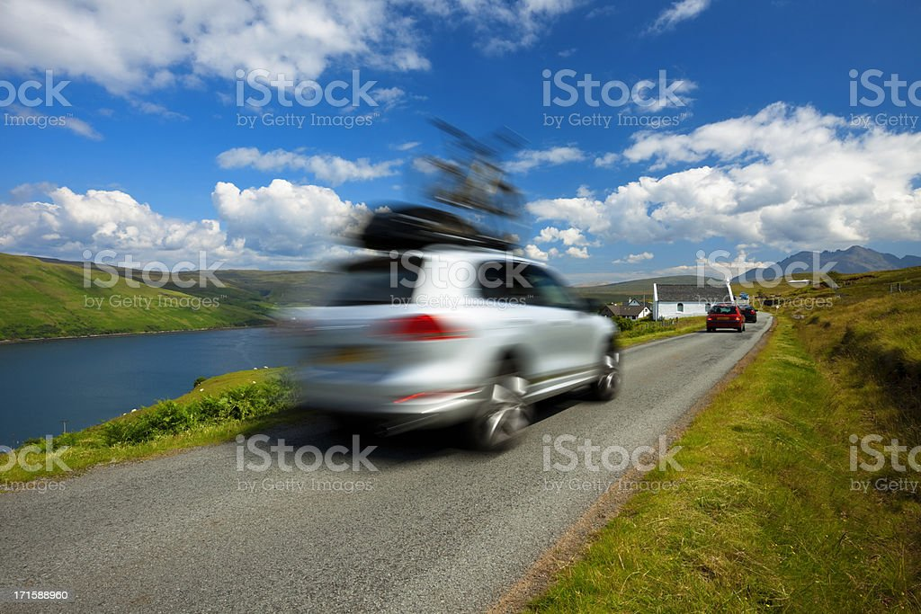 Car Driving with Bike on Roof, Isle of Skye, Scotland, stock photo