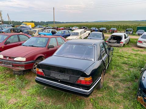 Grodno, Belarus-07.27.2021: Car dump. Broken cars. Auto-disassembly.