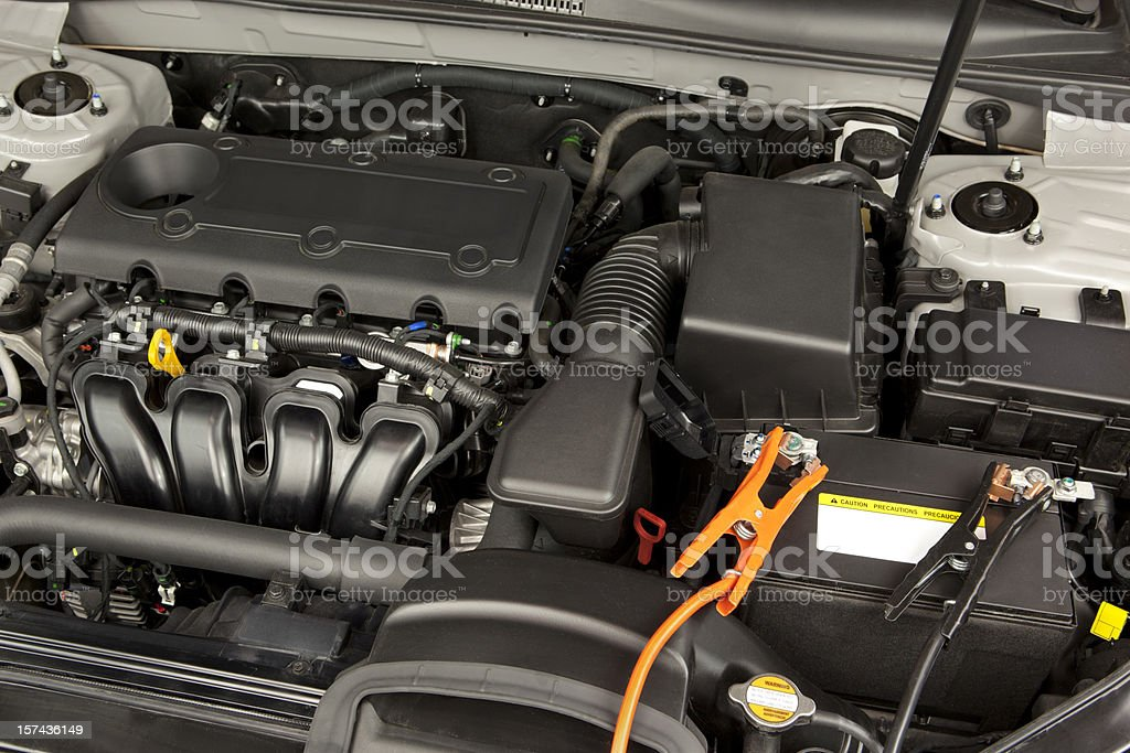 Car Engine and Jumper Cables stock photo