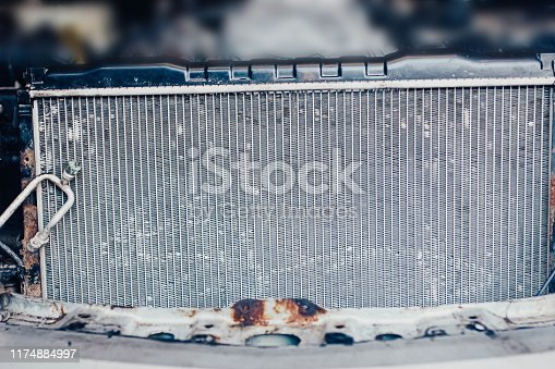 istock car engine cooling radiator in the garage. 1174884997