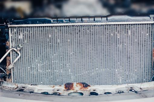 istock car engine cooling radiator in the garage. 1174884997
