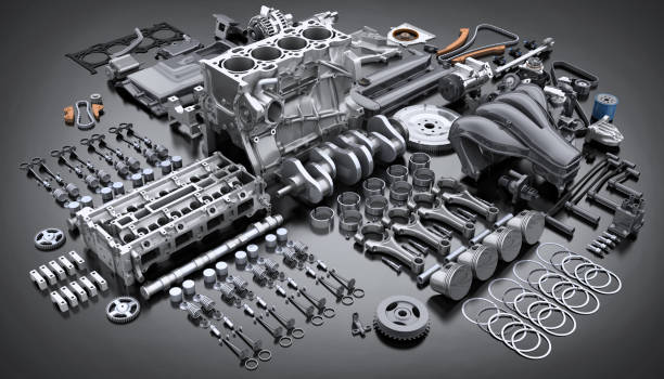 car engine disassembled. many parts. - motore foto e immagini stock