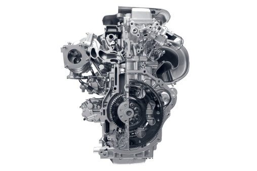 Concept of modern car engine isolated on white background.