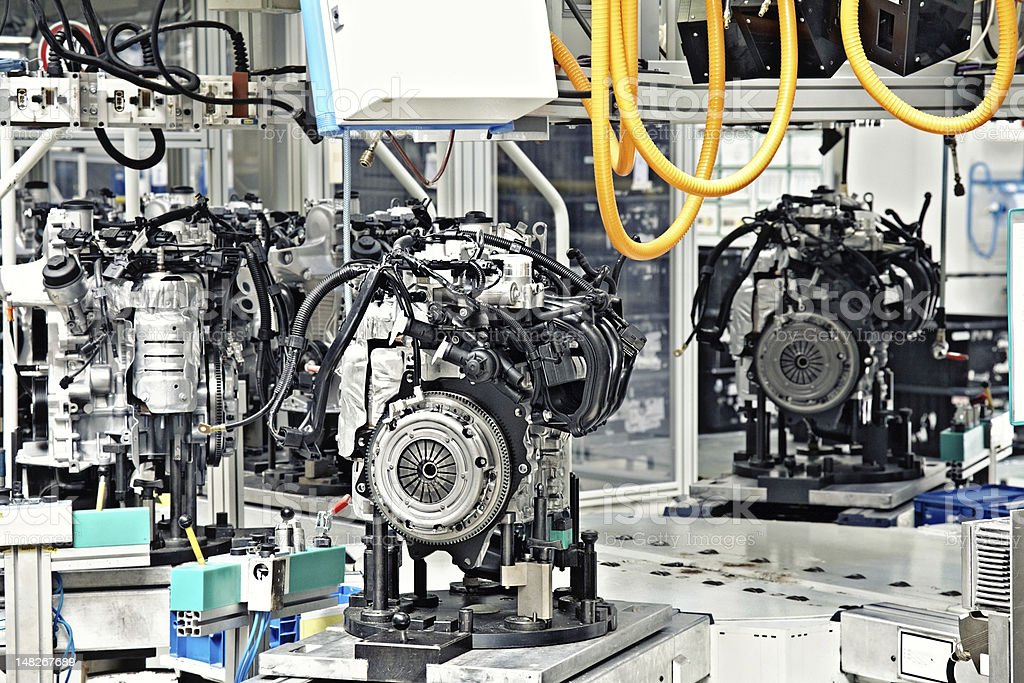 Car engine manufacturing in factory stock photo