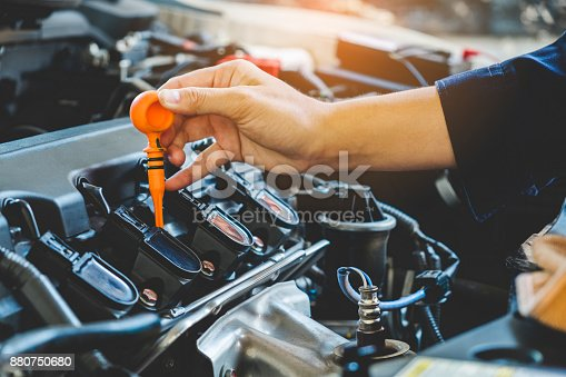 istock Car Engine oil mechanic working in auto repair service 880750680