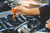 istock Car Engine oil mechanic working in auto repair service 880750680