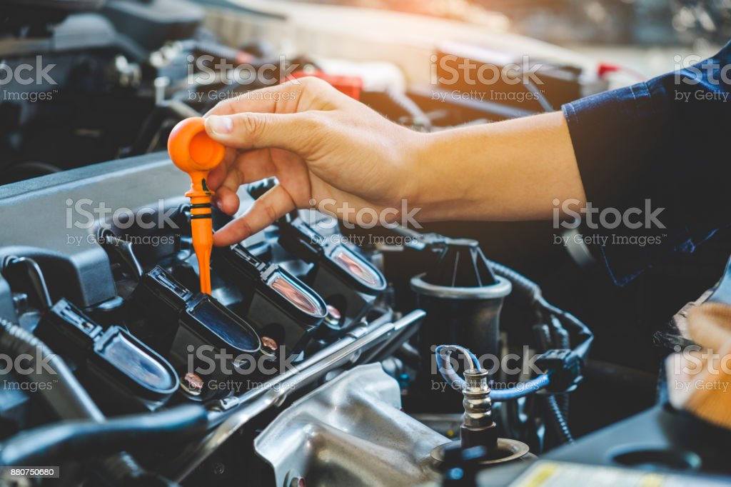 Car Engine oil mechanic working in auto repair service stock photo
