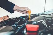istock Car Engine oil mechanic working in auto repair service 880750696