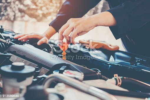 istock Car Engine oil mechanic working in auto repair service 913589530
