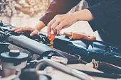 istock Car Engine oil mechanic working in auto repair service 913589530