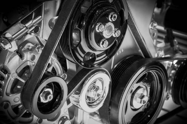 car engine View on pulley and belts on a car engine. engine stock pictures, royalty-free photos & images