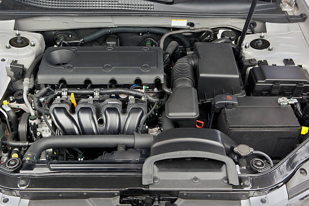 Car Engine Generic car engine close-up. Under the hood of a modern automobile. vehicle hood stock pictures, royalty-free photos & images
