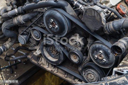 841283930 istock photo Car engine repair. Generator belt. 1195761518