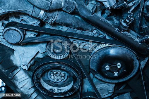 Car engine repair. Generator belt.