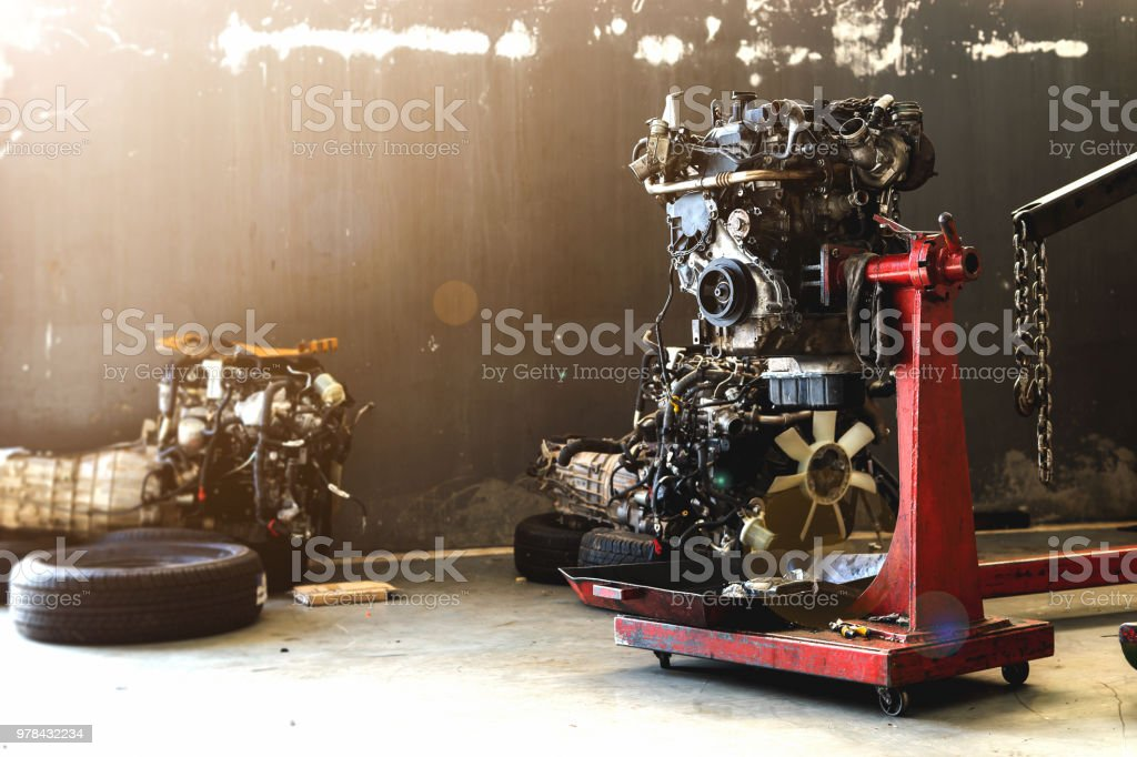 car engine repair in garage with soft-focus and over light in the background stock photo