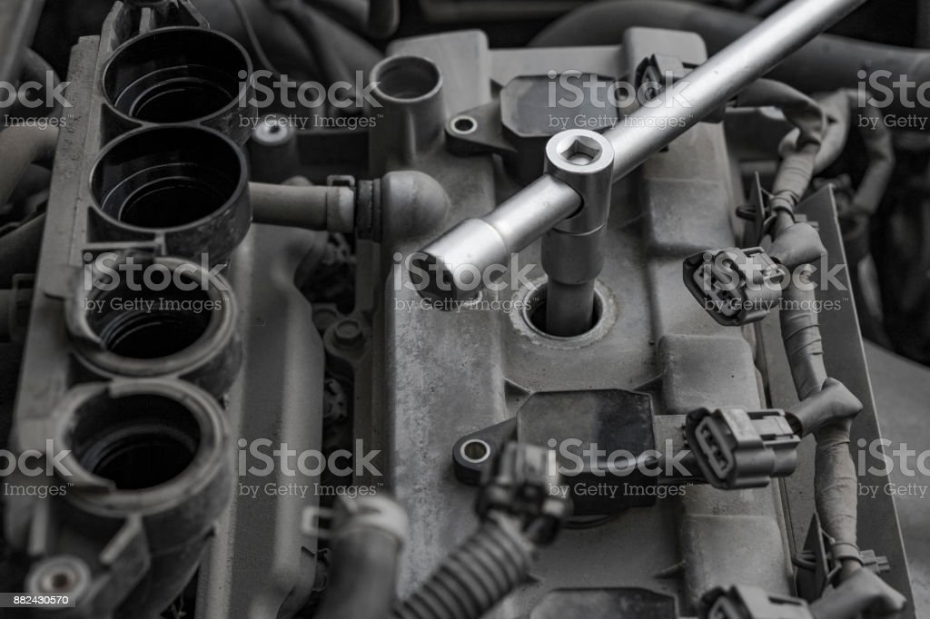 Car engine repair. Replacing the spark plugs in the engine. stock photo