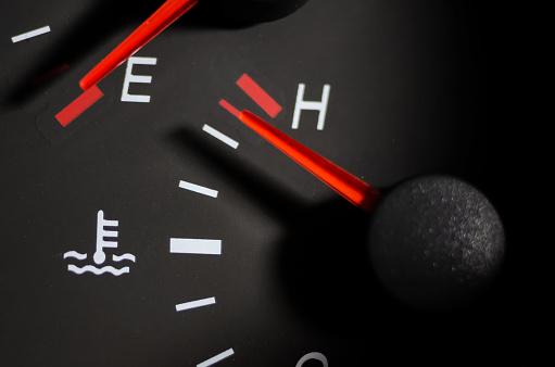 Car engine temperature sensor close up arrows
