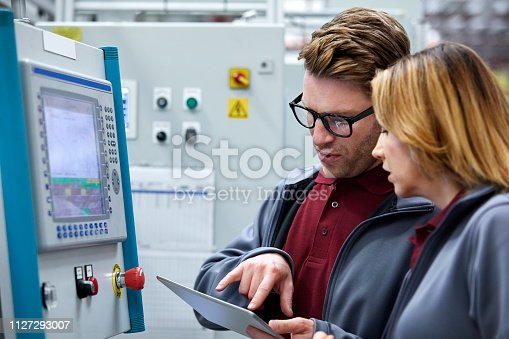 istock Car engineers using tablet pc by control panel 1127293007