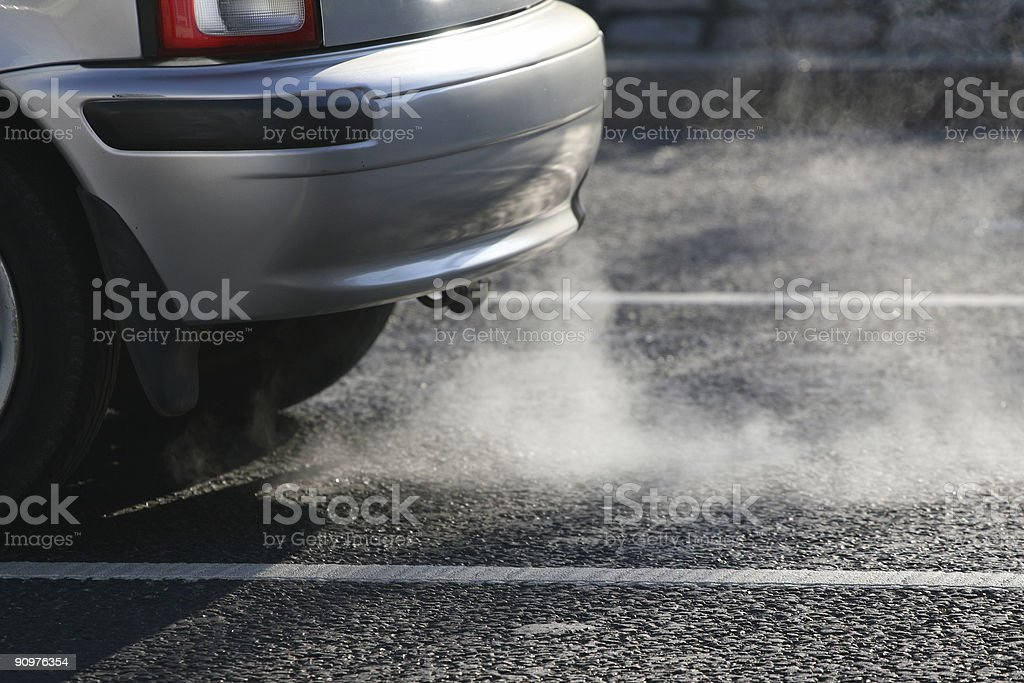 Car exhaust fumes coming from automobile polluting city air stock photo