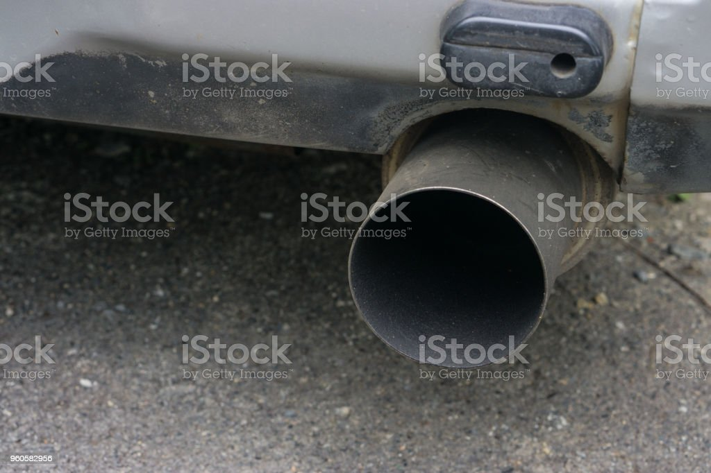 Car exhaust pipe., Close up intake exhaust under car vehicle. stock photo