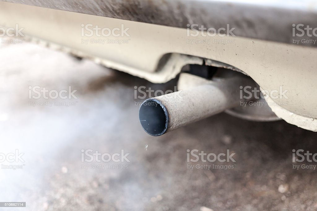 car exhaust pipe stock photo