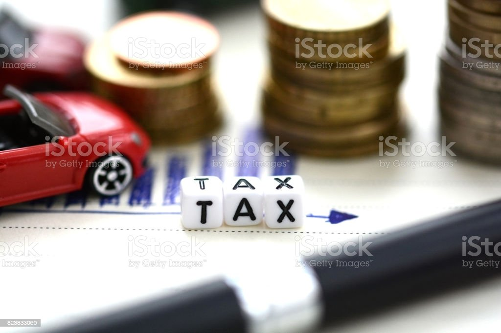 Car expenses concept with toy car and piles of money on hand drawn graphic stock photo