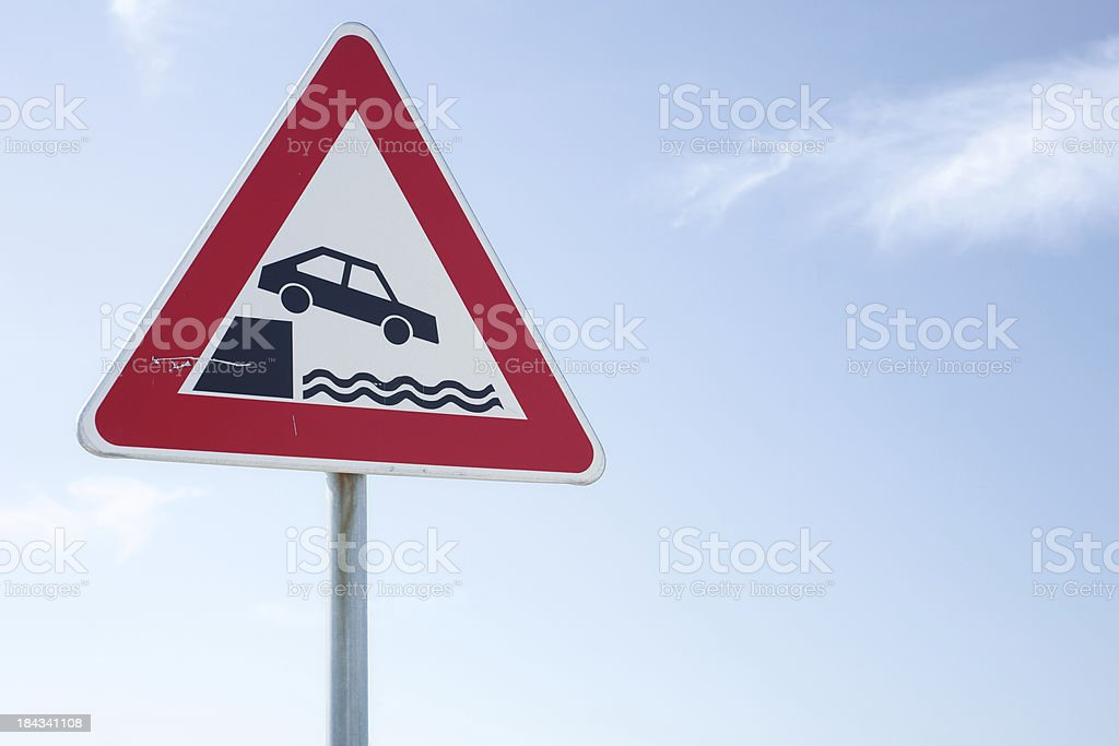 Car falling in water warning traffic sign royalty-free stock photo