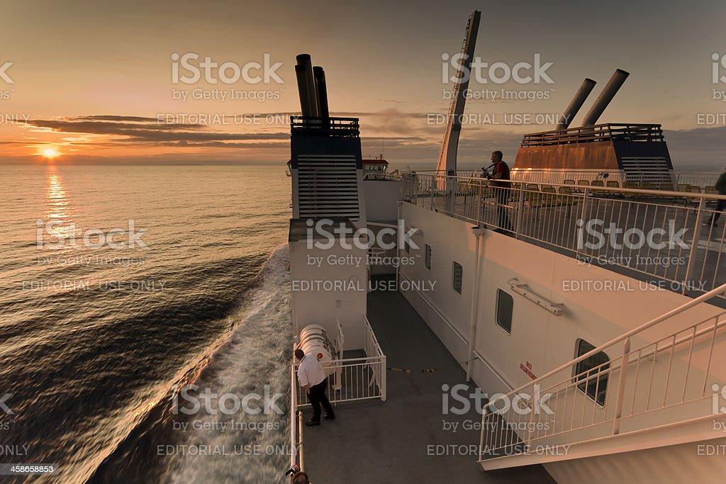 Car ferry heading for Shetland at sunset stock photo