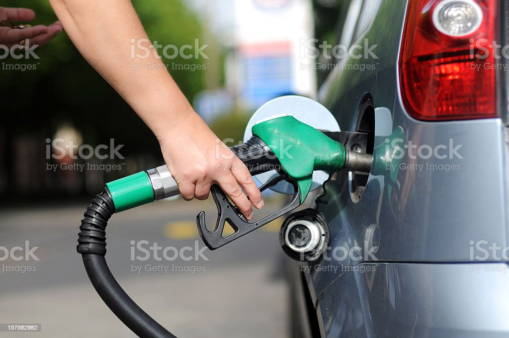 Car filled with fuel at gas station stock photo