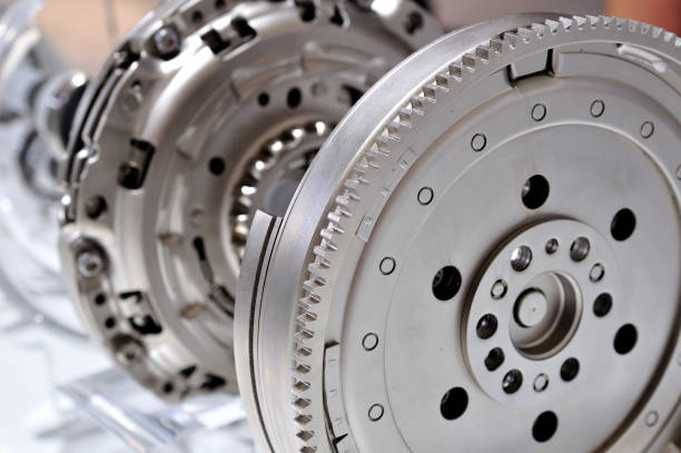 Car flywheel with a clutch in backgroung, with selective focus. Car flywheel with a clutch in backgroung, with selective focus. vehicle clutch stock pictures, royalty-free photos & images