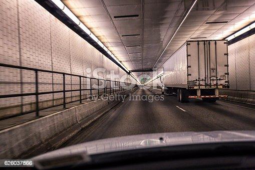 171150458istockphoto Car Following Trailer Truck Inside Pennsylvania Turnpike Lehigh Road Tunnel 626037866