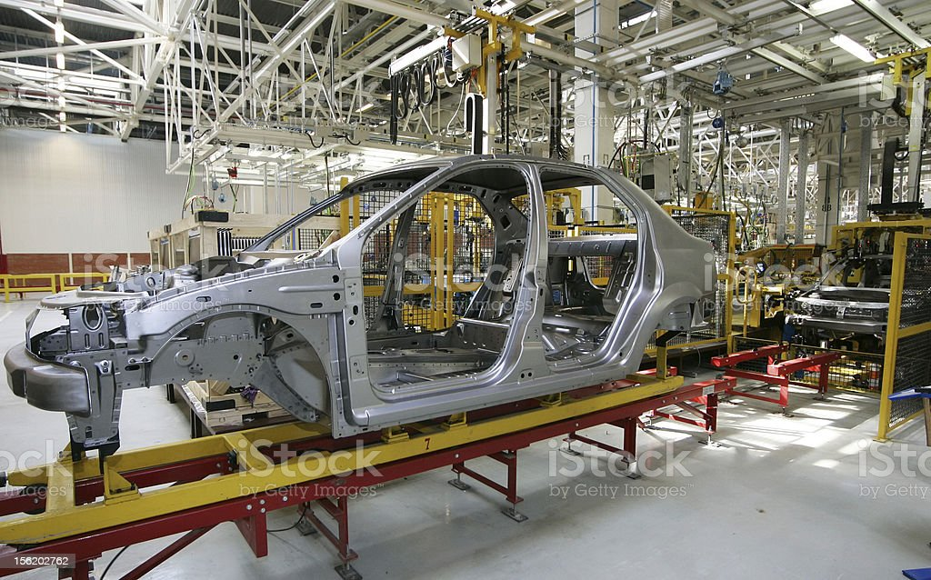 Car frame during assembly in production plant  stock photo