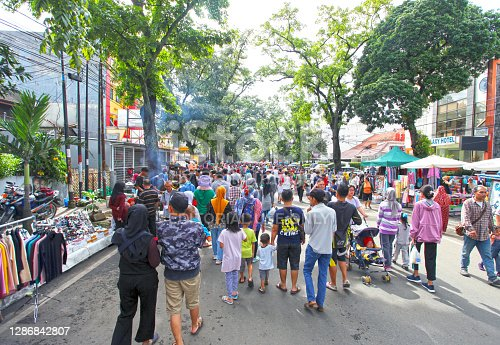 Bandung, West Java, Indonesia - December 11, 2016. Car Free Day is held every Sunday morning at the upper end of Jalan Buah Batu in the city of Bandung. Some people are selling various goods and some are walking around.