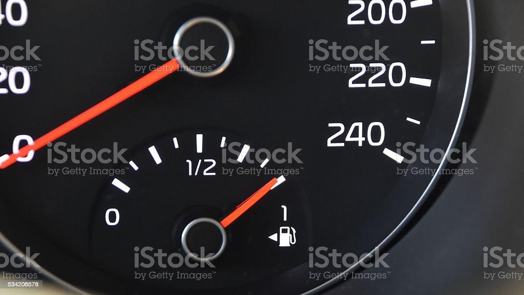 car fuel gauge indicating full stock photo