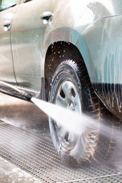 Car hand wash using high pressure washer stock photo