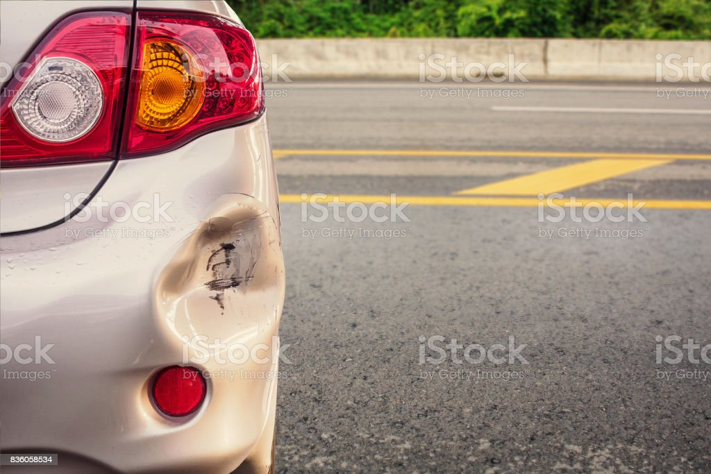 car has dented rear bumper damaged after accident stock photo