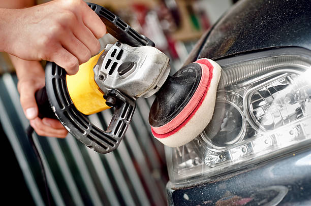 Car headlight cleaning with power buffer machine Car headlight cleaning with power buffer machine at service station headlight stock pictures, royalty-free photos & images
