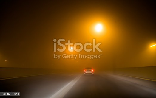Headlights of cars driving in fog at night