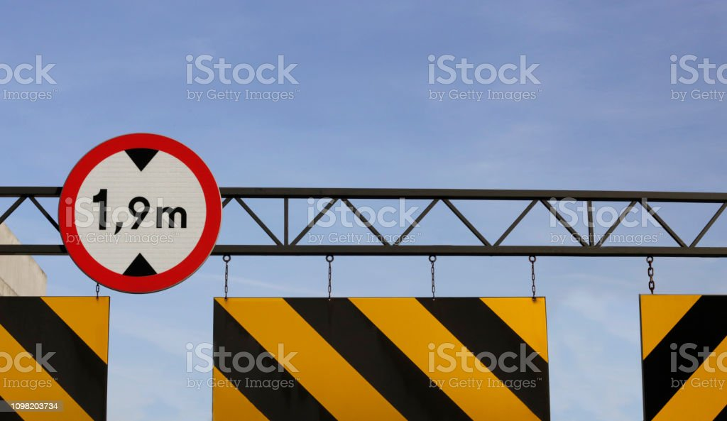 Car height limit road sign at parking lot entrance